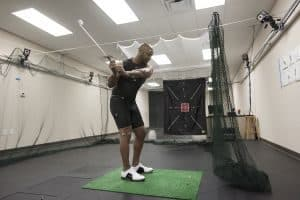 Man swinging golf club in the Gait Lab