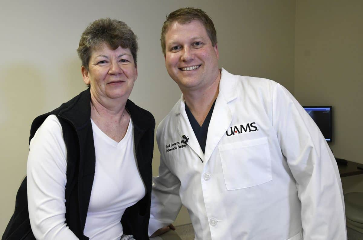 Woman posing with doctor