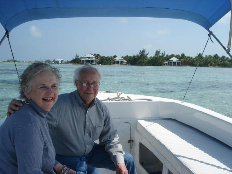 Couple in boat with island in background