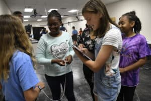 Girls in STEM participants with clipboards