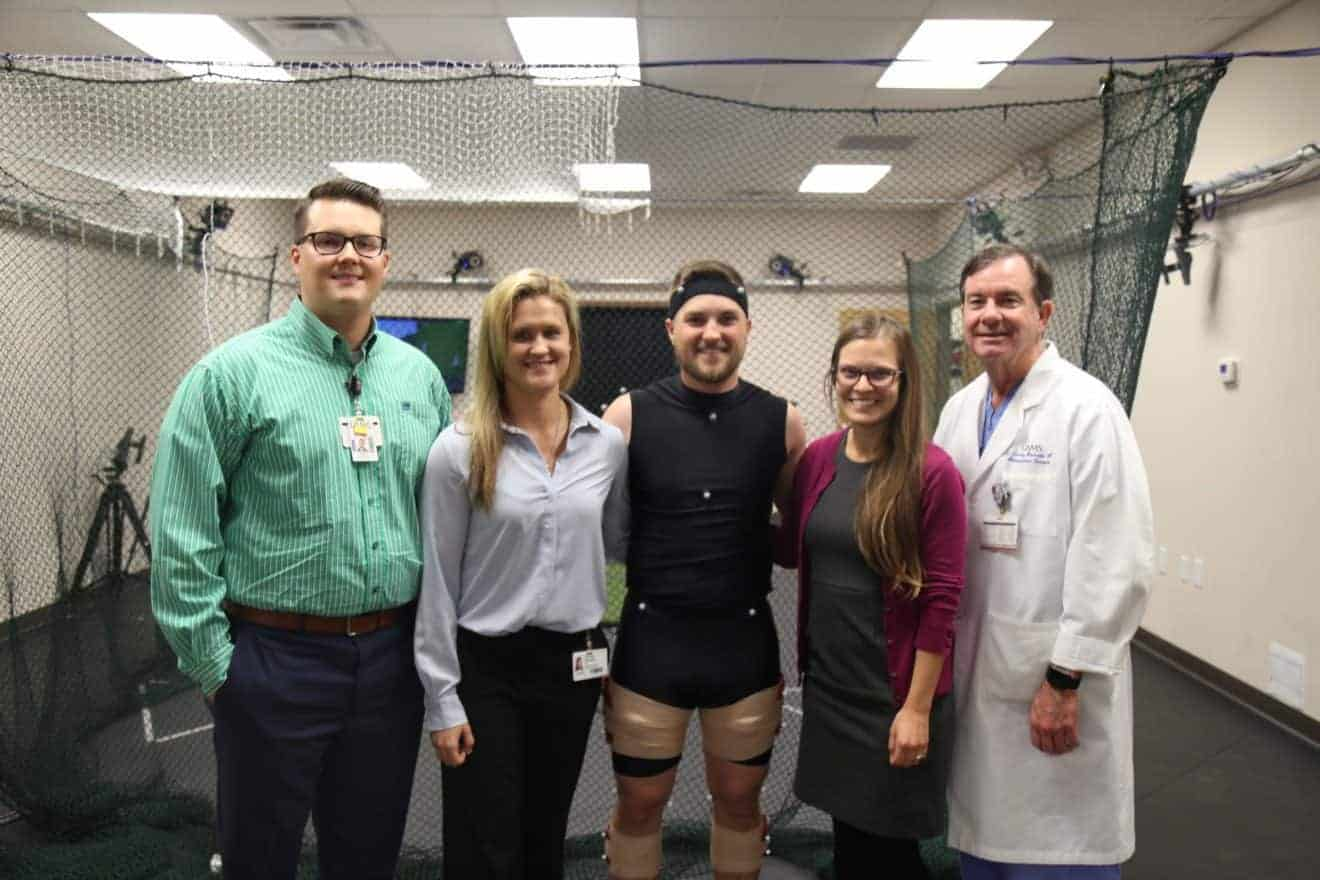 Ortho research team poses with golfer Austin Cook