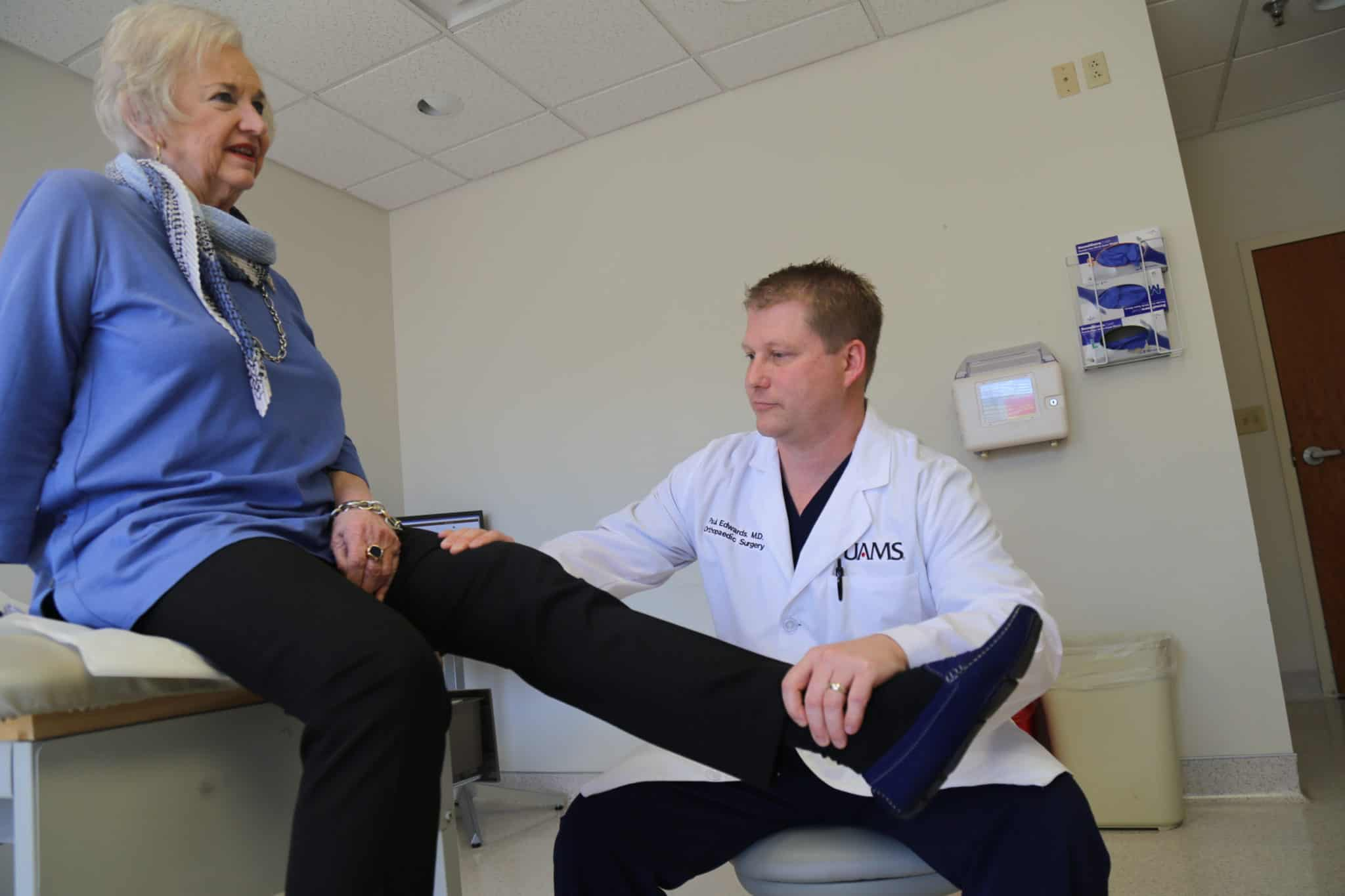 Dr. Edwards examines a patient's leg